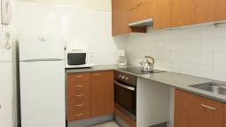 Kitchen in room MH Apartments Tetuan