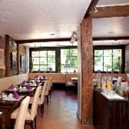 Restaurant/salle de petit-déjeuner Arthotel