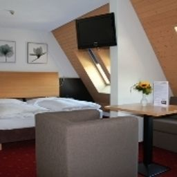 City_Hotel-Brunnen_Ingenbohl-Family_room-143726.jpg