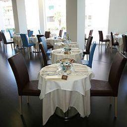 Restaurant/salle de petit-déjeuner Mioni Royal San