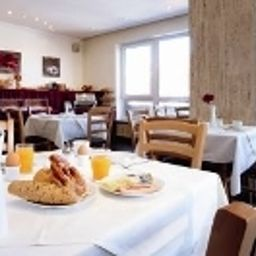 Breakfast room within restaurant Smart Stay Schweiz