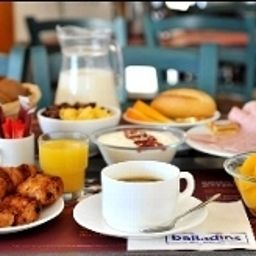 Breakfast room within restaurant Balladins Sarcelles