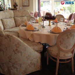 Breakfast room within restaurant Deutsches Haus Parkhotel