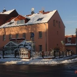 Фасад Mündelein Hotel-Pension