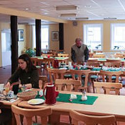 Breakfast room within restaurant Mann Gästehaus