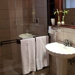 Cuarto de baño Plaza Real Suites & Apartments