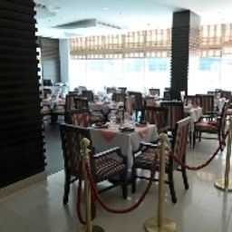 Breakfast room within restaurant Ramee Rose