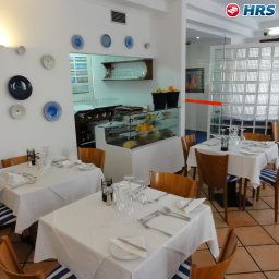 Breakfast room within restaurant Residencial Amparo Fotos