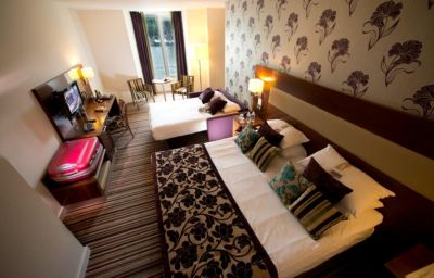 Four-bed room Ramada Plaza