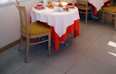 Sala de desayuno Executive Bergamo
