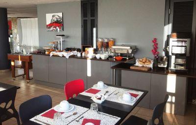 Sala de desayuno Le Baou