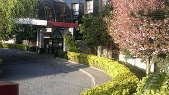 Buitenaanzicht GARDEN INN AND SUIT