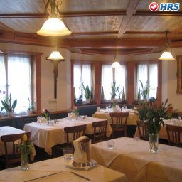 Breakfast room within restaurant Neumayr