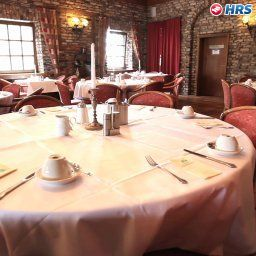 Breakfast room within restaurant De Poort Sporthotel