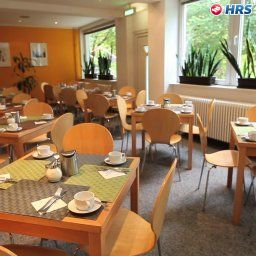 Breakfast room within restaurant enjoy City Messe