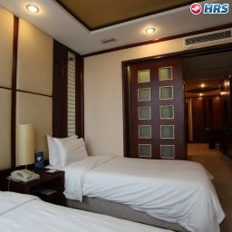 Chambre Golden Tulip Ashar Suites Shanghai Central