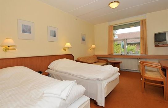 Four-bed room Hotel Lynggaarden
