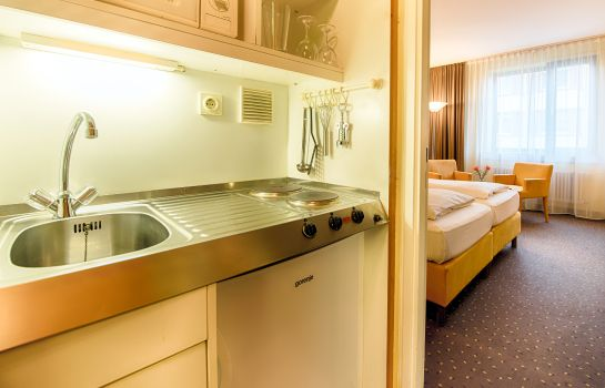 Kitchen in room ACHAT Comfort City-Frankfurt (ex Golden Leaf)
