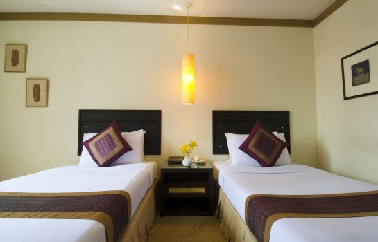 Single room (standard) The Tarntawan Hotel Surawong Bangkok formerly Tarntawan Place