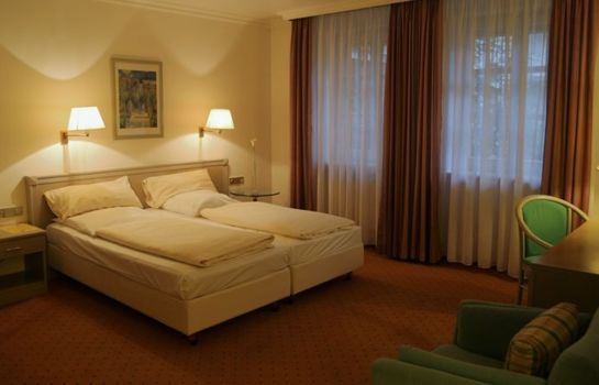 Four-bed room Asam Stadthotel