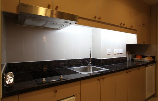Kitchen in room Green Court Residence City Center Shanghai Former:Green Court Serviced Apartment People Square