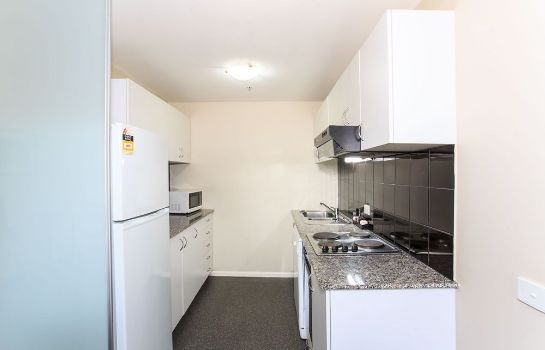 Kitchen in room The Paramount Serviced Apartments Melbourne