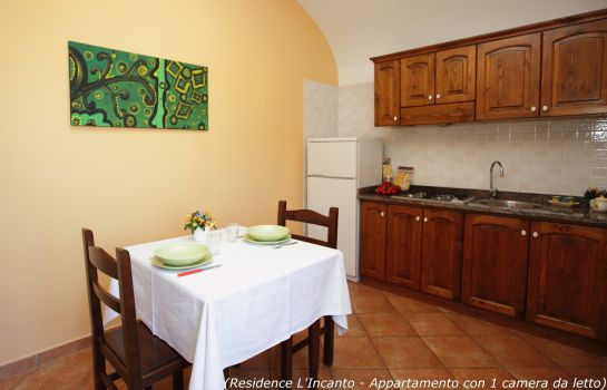 Kitchen in room L'Incanto Residence