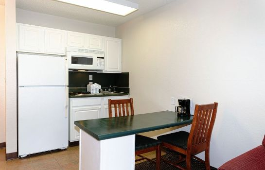 Kitchen in room InTown Suites Fort Myers