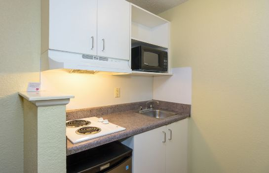 Kitchen in room Home-Towne Studios Gainesville