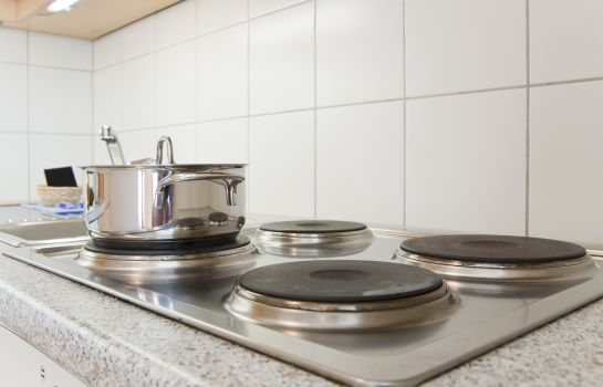 Kitchen in room Aldano Serviced Apartments