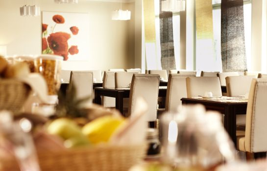 Breakfast room Hotel Kiel by Golden Tulip