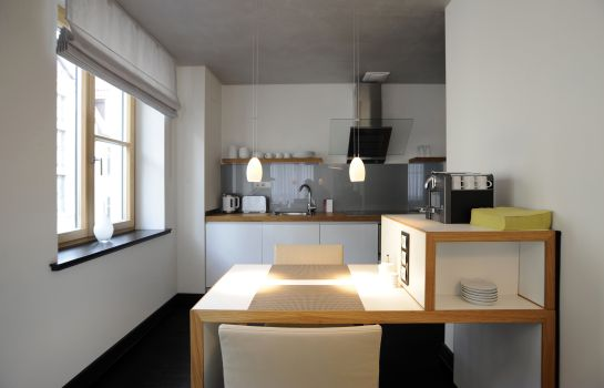 Kitchen in room rostock apartment LIVING HOTEL