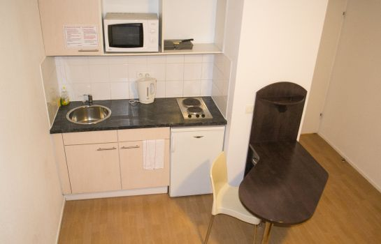 Kitchen in room City Residence Ivry