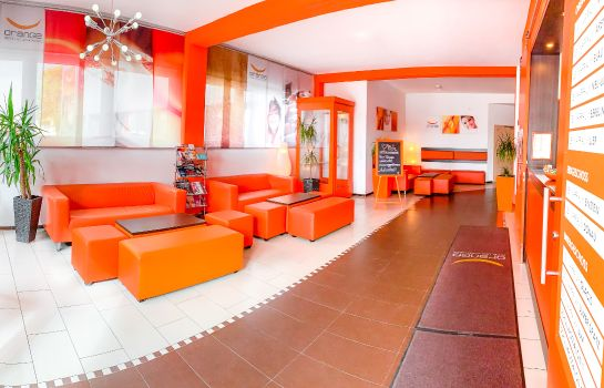 Recepcja Orange Hotel und Apartments