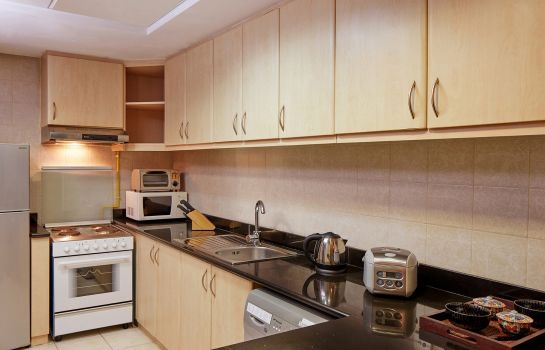 Kitchen in room ZiQoo Hotel Apartments