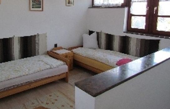 Four-bed room Torkolat Panzió