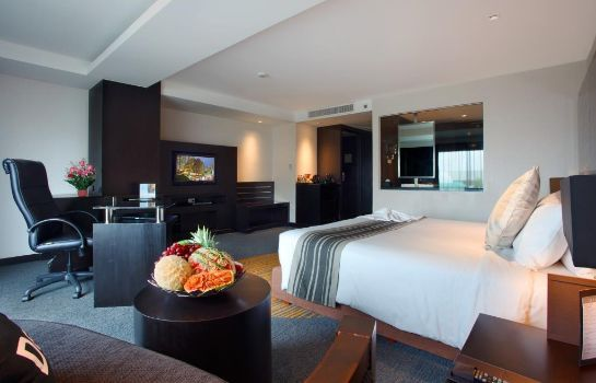 Room Golden Tulip Mandison Suites