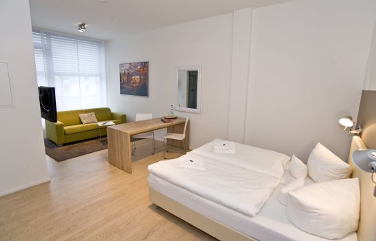 Four-bed room Schroeders Appartement Hotel