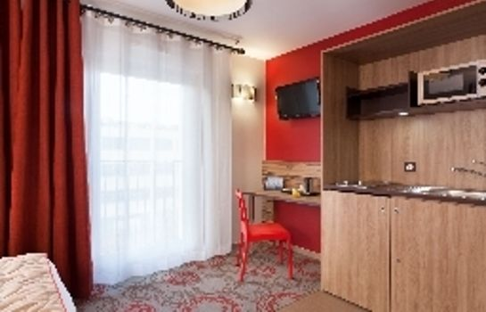 Kitchen in room Quality Suites Lyon Confluence Residence de Tourisme