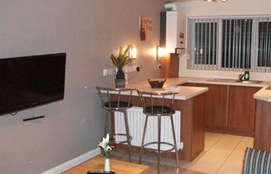 Kitchen in room Brookhill Serviced Apartments