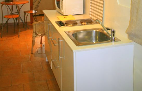 Kitchen in room BcnStop Sagrada Famlia Apartments
