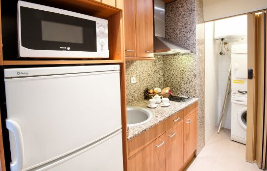 Kitchen in room Apartments Sata Park Güell Area