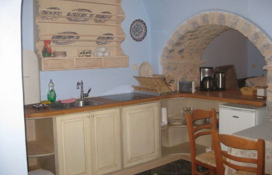Kitchen in room Traditional Hotel