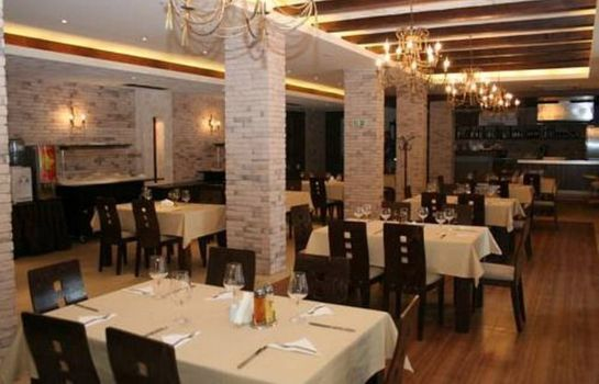 Restaurante Grand Royale Apartment Complex & Spa