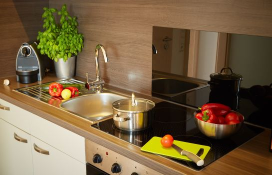 Cucina in camera Business Homes Das Apartment Hotel