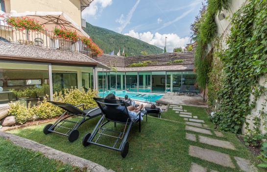 Garten AlpHoliday Dolomiti Wellness & Fun Hotel