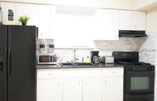 Kitchen in room Villas & Oceanfront Townhouses by Global Vacations