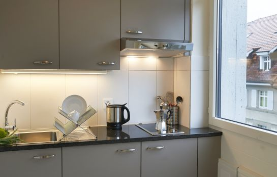Kitchen in room Congress Apartments by Hotel Du commerce
