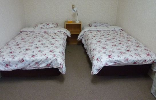 Four-bed room Pension Merry House