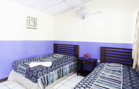 Four-bed room Hotel Hamacas
